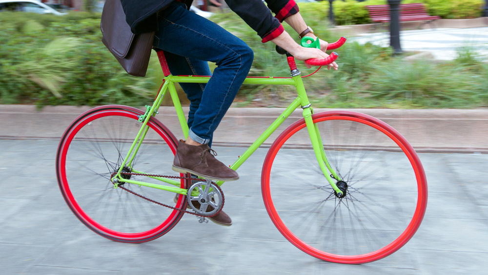 A person riding a colorful bicycle