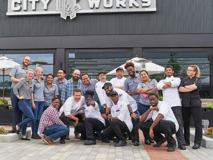City Works staff posing on the restaurant's patio