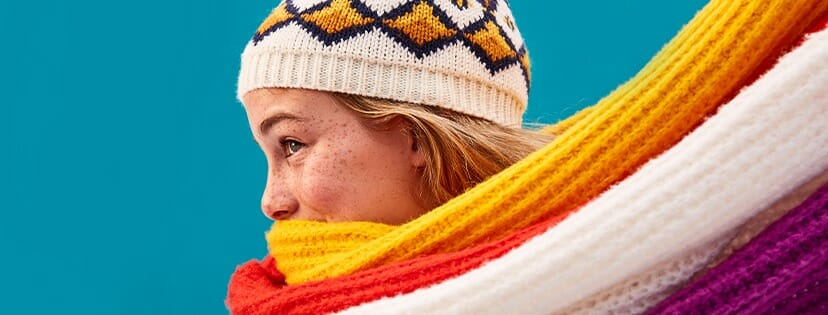A woman wearing a warm scarf and hat