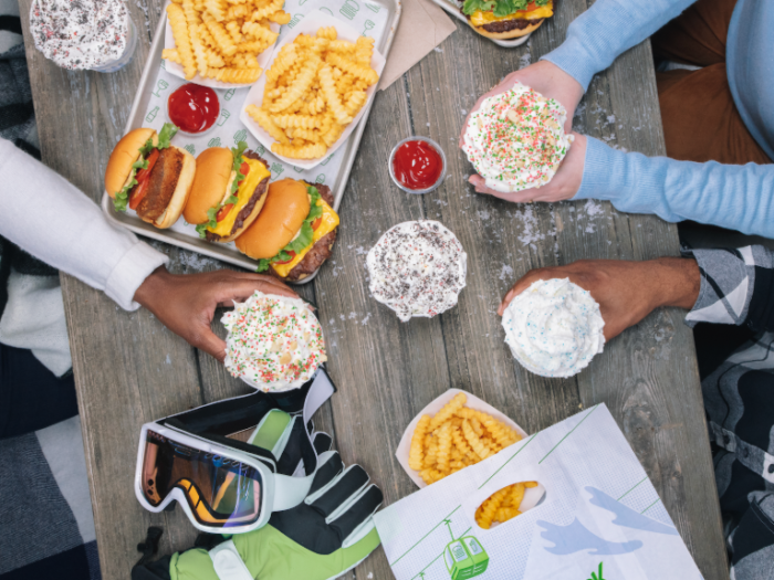 Friends enjoying a meal at Shake Shack