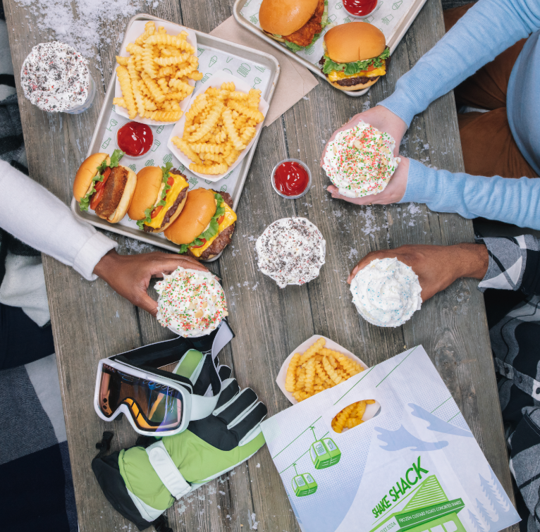 Friends enjoying a meal at Shake Shack
